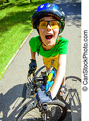 excited boy on a bike