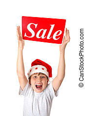 Excited boy with Sale Sign - An excited boy holding a sale...