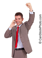 excited business man on the phone