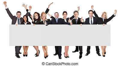 Group of excited business people presenting empty banner. Isolated on white