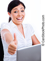 Excited business woman showing thumbs up