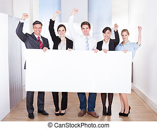 Excited Businessman Holding Placard