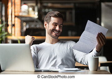 Excited businessman reading postal mail letter overjoyed by great news