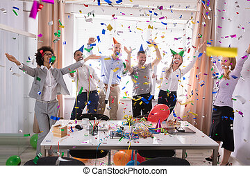 Excited Businesspeople Having Fun Raising Their Arms
