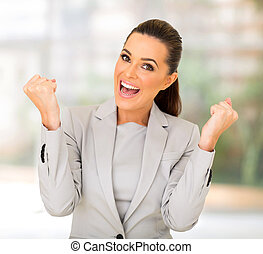 businesswoman waving fists in office