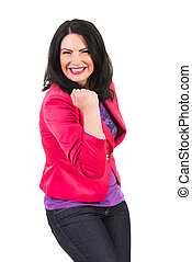 Excited casual woman showing fist and being extremely happy isolated on white background