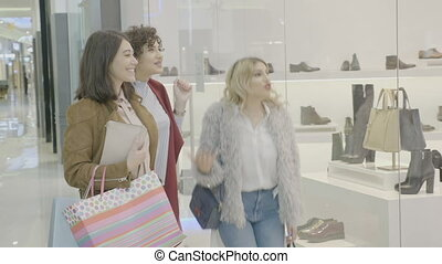 Excited celebrity women looking at the perfect pair of shoes...