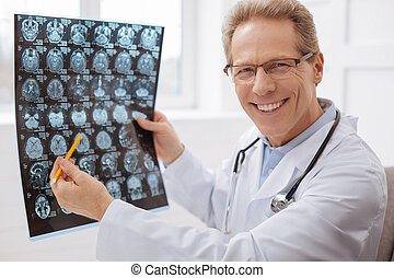 Excited committed neurosurgeon doing his job - Best in my...