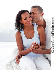 Excited couple finding out results of a pregnancy test in...