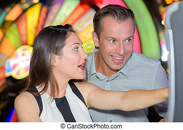 Excited couple playing casino game