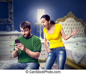 Excited couple playing wth a mobile phone