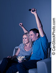 Excited Couple Watching Television