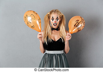 Excited crazy blonde woman in clown make-up