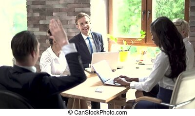 Excited creative business people giving high-five - Excited...