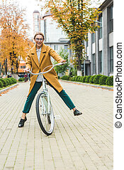 excited cycling woman