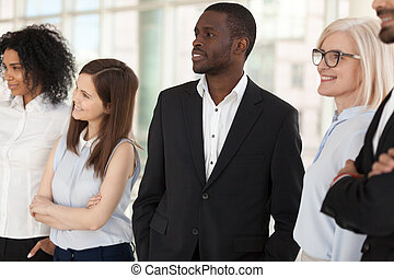 Excited diverse employees look in distance dreaming of success