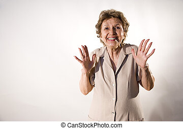 Excited elderly woman with wide grin