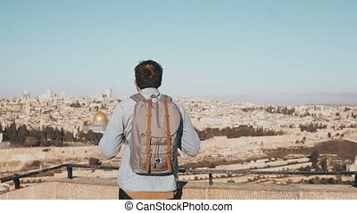 Excited European tourist male looks around. Israel,...