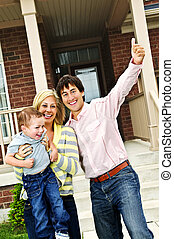 Excited family at home - Young excited family celebrating in...