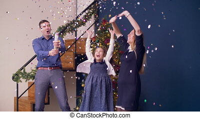 Excited family celebrating Christmas with firecracker -...