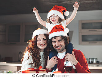Excited family celebrating winter holiday at home