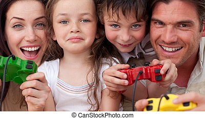 Excited family playing video games at home