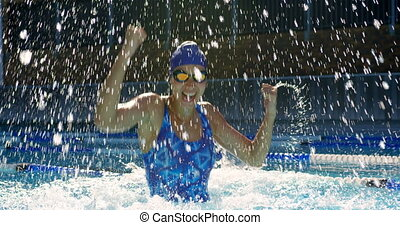 Excited female swimmer cheering in swimming pool 4k