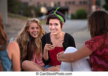 Excited Female Teens Looking at Phone