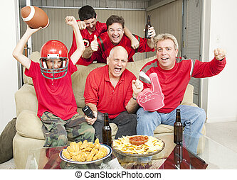 Excited Football Fans - Family of football fans cheering for...
