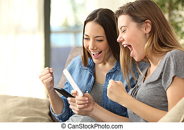 Excited friends checking content on line