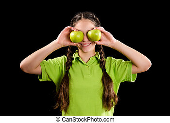 Excited funny girl with green apple on eyes
