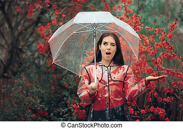 Excited Girl Happy in the Rain Holding Her Umbrella