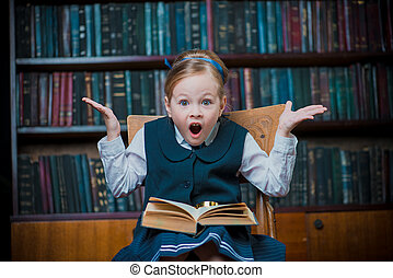 excited girl in a library