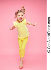 Excited girl jumping in studio