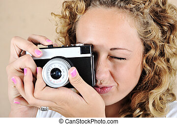 Excited girl with holding camera