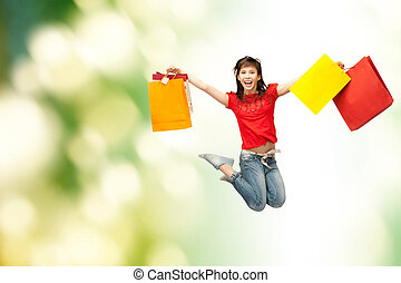 excited girl with shopping bags - shopping and movement...