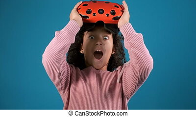 excited girl with virtual reality glasses clutches head - ...