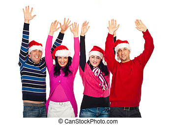 Excited group of friends with Santa hats