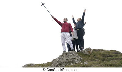 Excited group of tourists having fun taking selfie on...