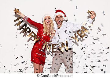 Excited happy young loving couple holding happy new year...