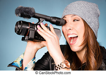 Horizontal Composition of Hip Young Adult Female Pointing Video Camera