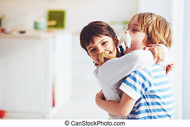 excited kids with mustaches embracing at home