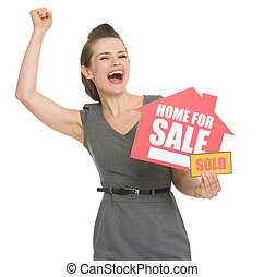 Excited landlord with home for sale sold sign isolated