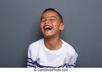 Excited little boy laughing - Close up portrait of an...