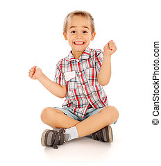 Excited Little Boy - Very excited little guy sitting and...