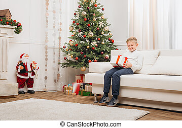 little boy with christmas gift