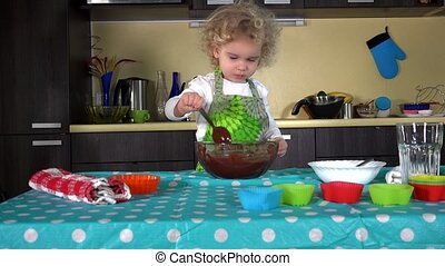 Excited little girl mixing preparing dough for cake baking in kitchen