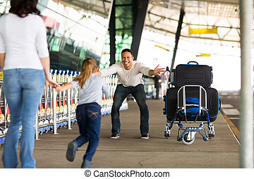 little girl running to her father at airport - excited ...