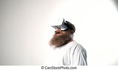 Excited male fatso having fun with virtual reality goggles