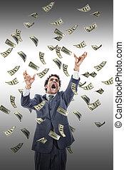 excited man catching money falling around him, businessman...